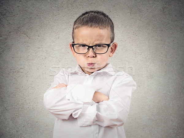 Angry boy puffing out his cheeks  Stock photo © ichiosea