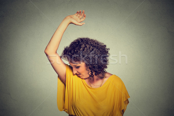 woman, smelling, sniffing her wet armpit, something stinks, very bad foul odor Stock photo © ichiosea