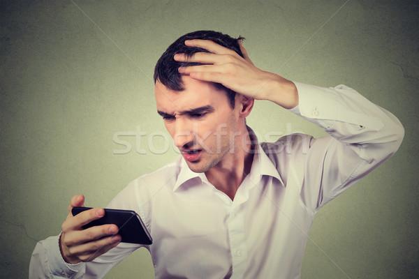 shocked man feeling head, surprised he is losing hair, receding hairline Stock photo © ichiosea