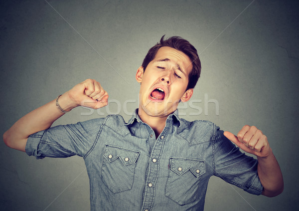 Sleepy man yawning stretching arms back Stock photo © ichiosea