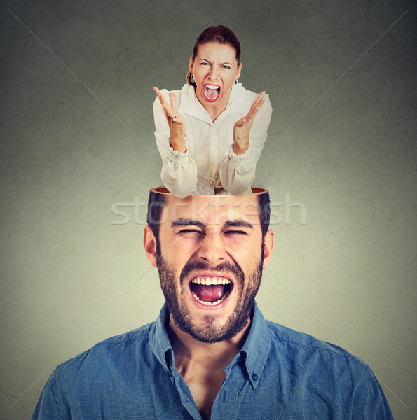young angry woman screaming inside head of a frustrated guy   Stock photo © ichiosea