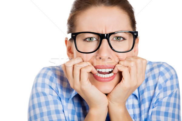 Anxious, nervous woman, in black glasses biting her fingernails Stock photo © ichiosea