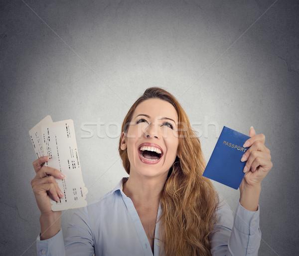 Stock photo: excited tourist woman holding passport flight ticket