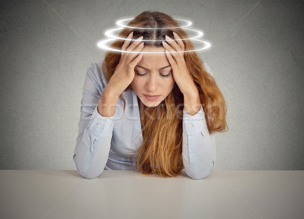 Woman with vertigo. Young female patient suffering from dizziness  Stock photo © ichiosea