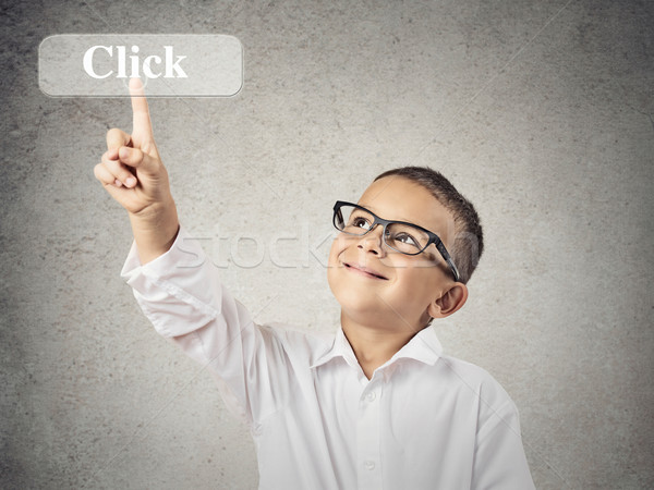 Boy pushing on Click button Stock photo © ichiosea