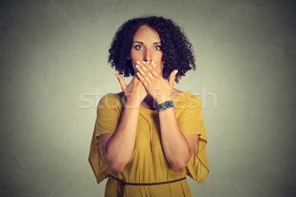 woman covering closed mouth with hands. Speak no evil concept Stock photo © ichiosea