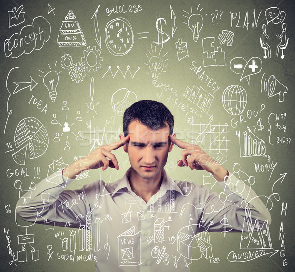 Young business man thinking hard how to manage difficult new project  Stock photo © ichiosea