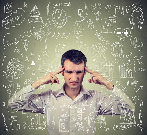 молодые деловой человек мышления трудный новых проект Сток-фото © ichiosea