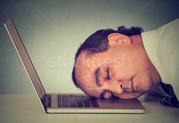 Side profile businessman sleeping on a laptop at his desk, tired middle aged guy employee Stock photo © ichiosea