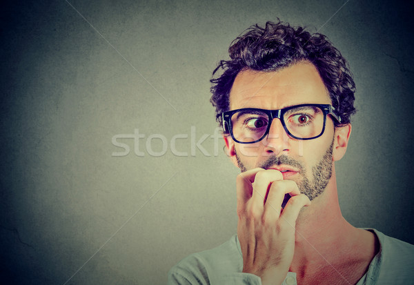 Anxious stressed young man looking away Stock photo © ichiosea