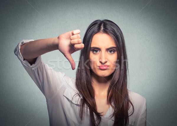 Infelice donna pollice giù gesto guardando Foto d'archivio © ichiosea