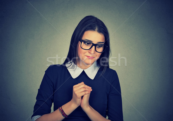 Shy anxious woman looking down   Stock photo © ichiosea