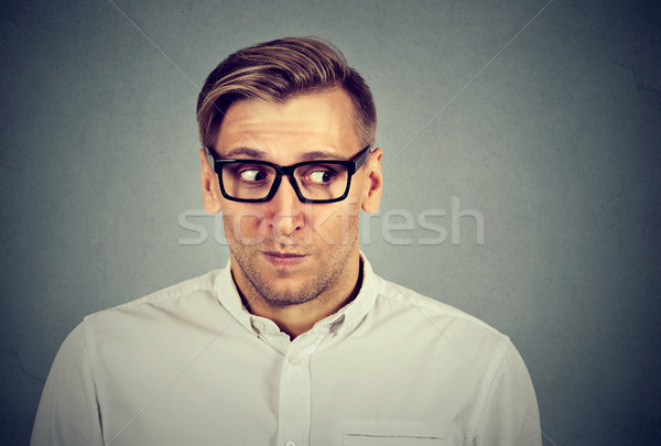 Preoccupied worried man in unpleasant, awkward situation  Stock photo © ichiosea