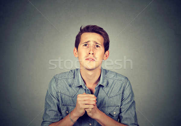 Desperate man showing clasped hands, sorry for mistake  Stock photo © ichiosea