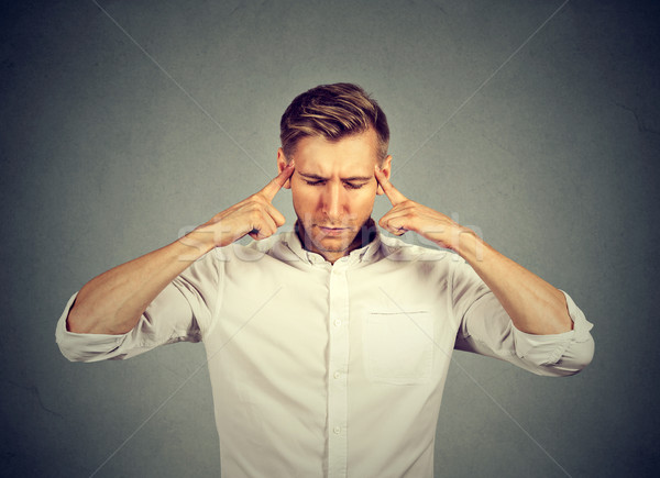 sad young man with worried stressed face expression looking down Stock photo © ichiosea