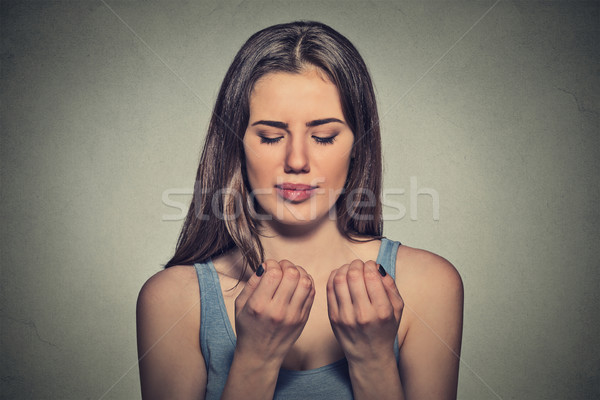 Worried woman looking at hands fingers nails obsessing about cleanliness Stock photo © ichiosea