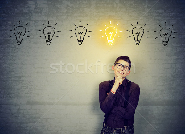 man leaning on brick wall looking for best solution idea  Stock photo © ichiosea