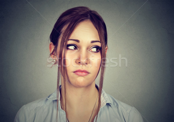 portrait of a sad woman looking sideways   Stock photo © ichiosea