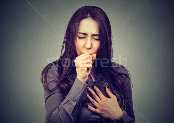 Stock photo: Young woman coughing