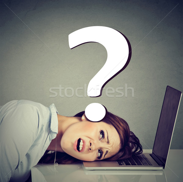 Stressed woman resting head on laptop under pressure of employment problems  Stock photo © ichiosea