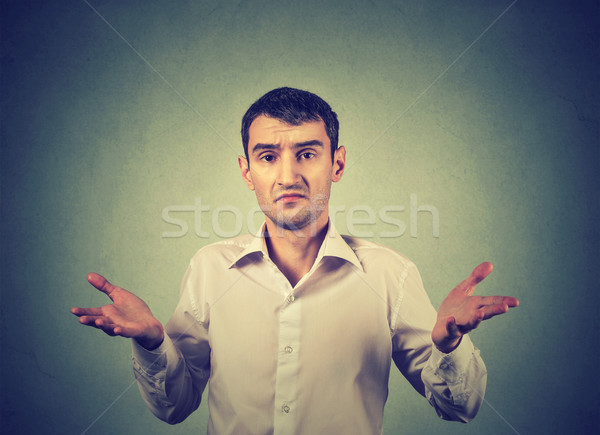 Ignorance and arrogance. Man shrugging shoulders so what I don't know gesture  Stock photo © ichiosea