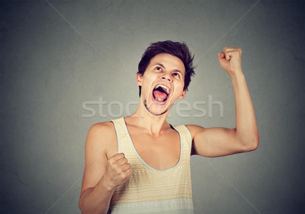 happy successful student, man winning fists pumped celebrating success  Stock photo © ichiosea