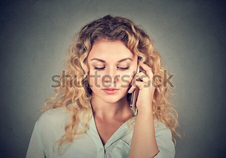 Young sad woman talking on mobile phone Stock photo © ichiosea