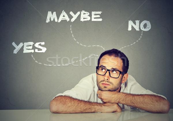 Gondolkodik határozatlan üzletember ül asztal férfi Stock fotó © ichiosea