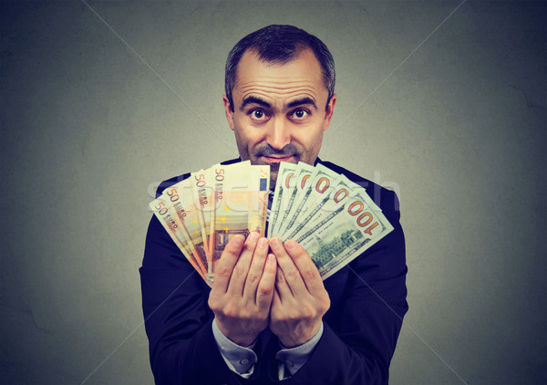 man holding money euro and dollars banknotes  Stock photo © ichiosea