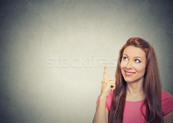 woman thinking looking up pointing with finger at blank copy space Stock photo © ichiosea