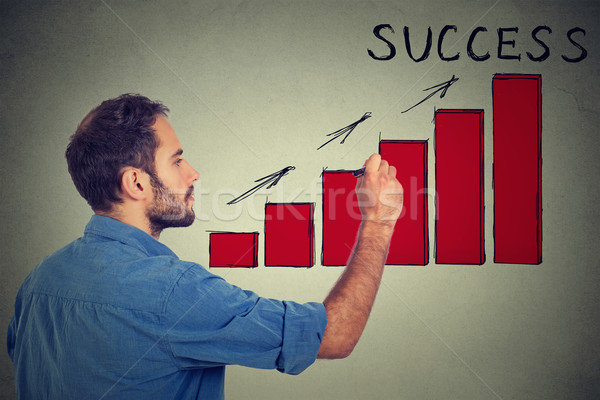 Man drawing future successful earnings result chart  Stock photo © ichiosea