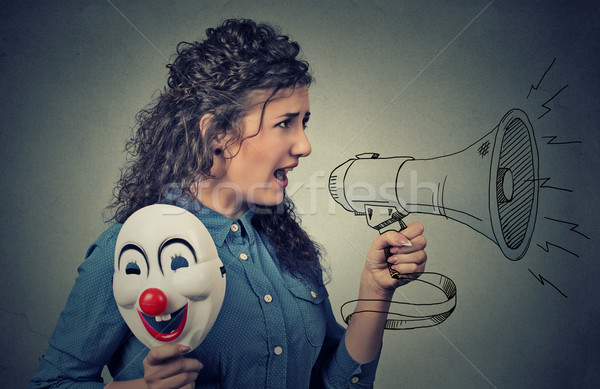 Woman with megaphone and clown mask screaming  Stock photo © ichiosea