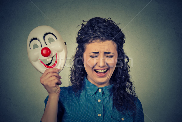 upset crying screaming woman holding a clown mask expressing cheerfulness Stock photo © ichiosea