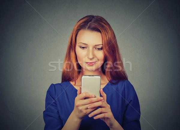 Colère femme malheureux agacé quelque chose téléphone portable Photo stock © ichiosea