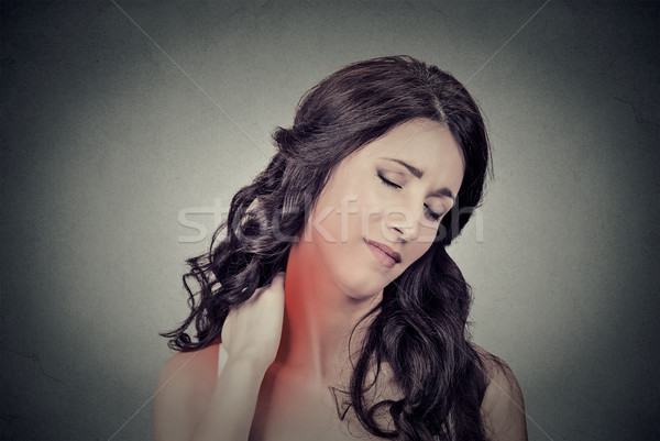 tired woman massaging her painful neck  Stock photo © ichiosea