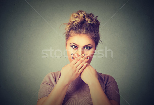 Oops! Surprised scared woman covering mouth with hands and staring at camera Stock photo © ichiosea