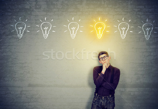 man leaning on a wall looking for best solution idea  Stock photo © ichiosea