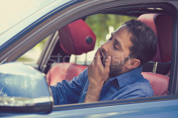 sleepy fatigued yawning exhausted young man driving his car Stock photo © ichiosea