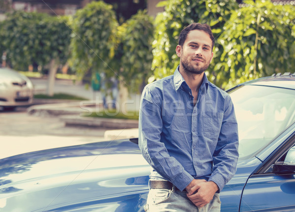 Handsome man standing in front of his car Stock photo © ichiosea