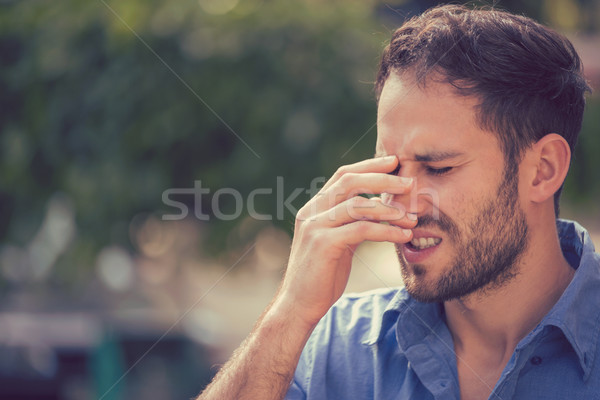 Too much to handle. Stressed man standing outdoors Stock photo © ichiosea