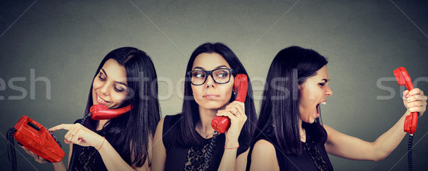 woman dialing number on vintage telephone curiously listening and getting angry screaming on the pho Stock photo © ichiosea