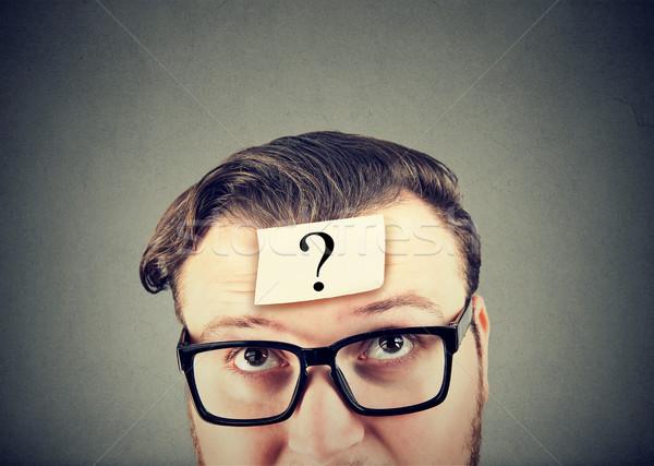 Adam genç gözlük soru akla Stok fotoğraf © ichiosea