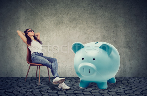 woman with big piggy bank relaxing sitting on chair  Stock photo © ichiosea