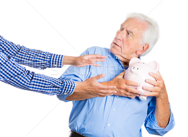 Stock photo: grandpa protecting his savings
