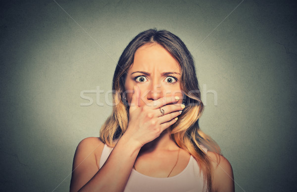 Closeup concerned scared shocked woman covering her mouth  Stock photo © ichiosea