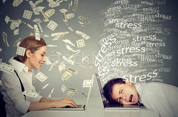 Stock photo: Woman under cash rain working on laptop next to stressed man