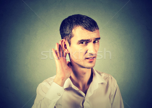 hard of hearing man placing hand on ear asking to speak up  Stock photo © ichiosea