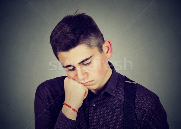 Сток-фото: печально · человека · глядя · вниз · изолированный · серый
