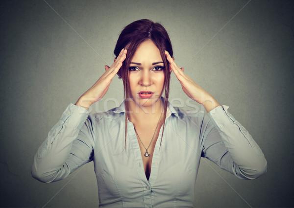 Stressed sad woman with headache  Stock photo © ichiosea