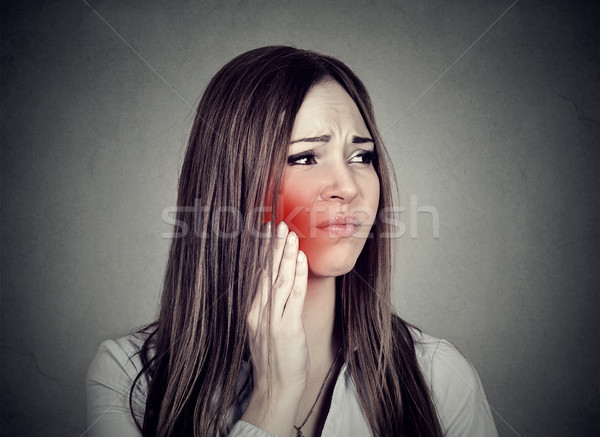 woman with sensitive toothache suffering from pain touching outside mouth   Stock photo © ichiosea